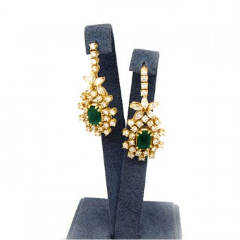 Ladies 14k Yellow Gold Earrings with emerald stone in center