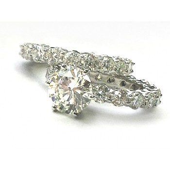 Ladies 14K White Gold Eternity Ring with 3.02 ct Round Brilliant-Cut Diamond in Center along with a matching Eternity Band